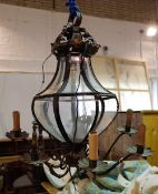 A late Victorian black painted metal six branch octagonal chandelier of tapering form,