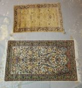 An Indian Tree of Life rug, 162cm x 95cm, and a Turkish rug with flower filled vase, 127cm x 82cm.