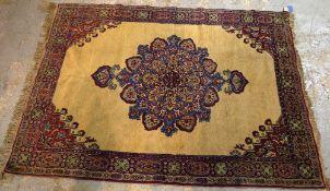 A Mashad rug, 214cm x 153cm.
