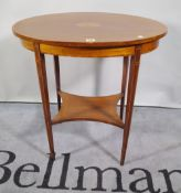 An Edwardian satinwood banded oval occasional table on square tapering supports,