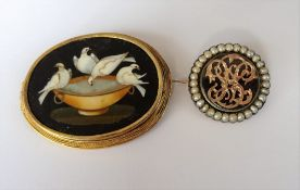 An oval Florentine pietra dura brooch, designed as Pliny's doves drinking from a cup,