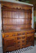 A late Victorian oak dresser with two long drawers and four short drawers,