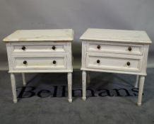 A pair of Louis XVI style white painted two drawer bedside chests on fluted tapering supports,
