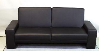 A 20th century faux black leather sofa bed, 193cm wide.