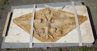 A large 20th century relief moulded plaster plaque depicting a coat of arms, 122cm wide x 61cm high.