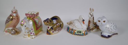 Six Royal Crown Derby Imari paperweights including a llama, swan, chameleon, parrot,