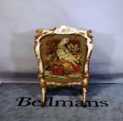 A late 19th century giltwood framed tapestry fire screen, 76cm wide x 106cm high.