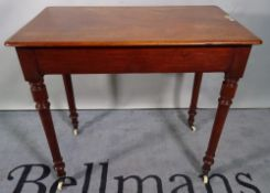 A Victorian mahogany rectangular hall table with single frieze drawer on turned supports,
