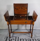Britisher; a mid-20th century oak folding writing desk on barleytwist supports,