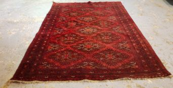 An Afghan carpet, 280cm x 210cm.