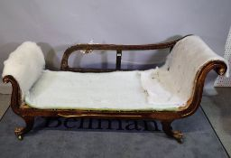 A 19th century French faux rosewood chaise longue with double scroll ends on swept sabre supports,