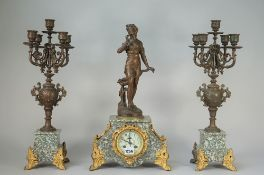 A three-piece French marble and spelter clock surmounted by a female figure titled 'Le Bouton