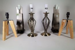 A group of three pairs of 20th century decorative table lamps, including metal and wooden examples.