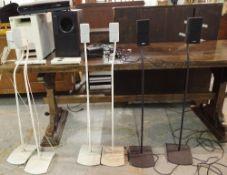 A quantity of Bose audio surround sound equipment.