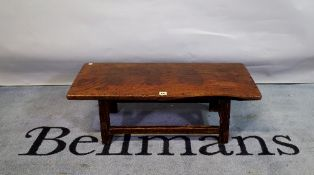 A 19th century Chinese elm low table, 82cm wide x 27cm high.