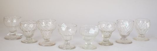 A group of eight bonnet glasses, late 18th century, with various moulded bowls on circular feet,