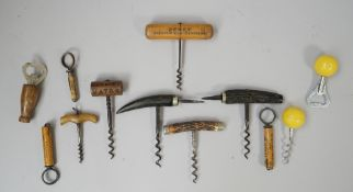 Four late 19th century direct pull corkscrews, each with horn handle,