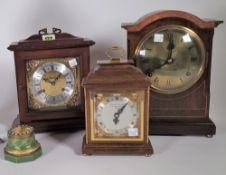 A group of four late 19th/ early 20th century mantel clocks.