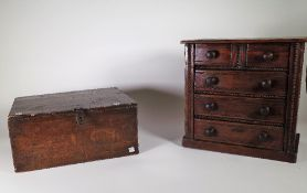 An early 20th century stained pine table top chest of two short and three long drawers,