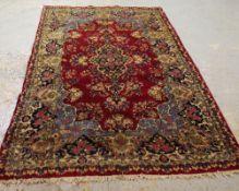 A Kerman rug, 227cm x 140cm.