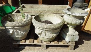 Garden statuary; a pair of 20th century reconstituted stone garden urns with swag decoration,