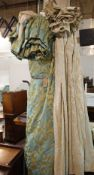 Designers Guild; a pair of lined curtains with gilt and turquoise foliate design,