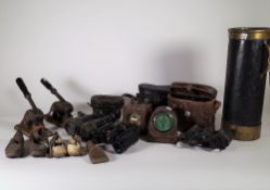 Colletables, inlcuding; a quantity of early 20th century binoculars, two stamp presses,
