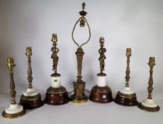 A quantity of 20th century gilt metal table lamp bases and a group of turned wooden wall light