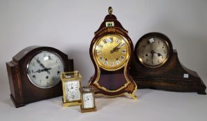 A 20th century carriage clock, another smaller and three 20th century mantel clocks, (5).