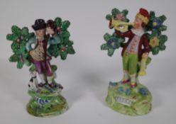 A similar pair of 19th century Pearlware figures by Walton, each 9cm high.