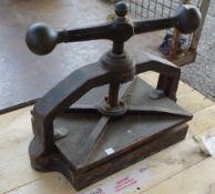 An early 20th century book press, 49cm wide, and a modern fire grate, (2).