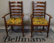 A pair of 18th century style oak ladder back open armchairs, (2).