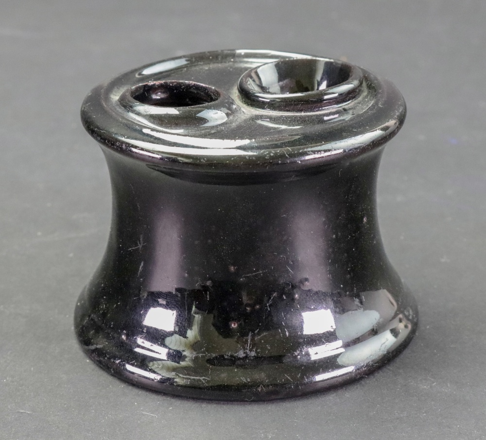 Lot 13 - A Staffordshire 'Jackfield' style inkwell, circa 1760-70, of capstan form,