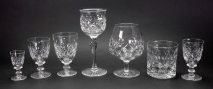 A suite of Tudor facet and diamond cut glassware, with star cut bases, 90 pieces,