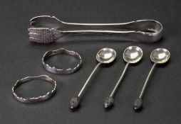 A pair of serving tongs, detailed sterling, makers mark rubbed,