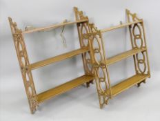A set of Regency style grained faux pine three tier wall hanging shelves,