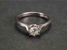 An 18ct white gold and diamond-set single-stone ring,