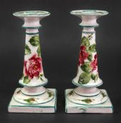 A pair of Wemyss earthenware candlesticks, circa 1900, of tapered cylindrical form,