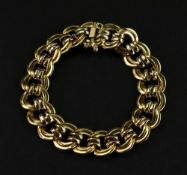 An 18ct gold bracelet of double circular-link design to a box and tongue clasp and safety clasp,