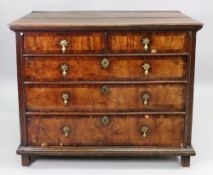 A late 17th century oak and walnut chest of drawers, of panelled construction,