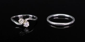 An 18ct white gold, platinum and diamond set ring, of cross over design,