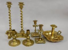 A pair of brass spiral column candlesticks, in late 17th century style,