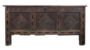 A late 17th century oak coffer, of panelled construction, with hinged top,