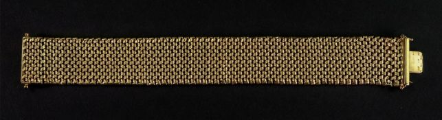 A 9ct gold wide fancy chevron-link bracelet, of textured design,