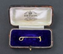 A 14ct gold brooch, in the form of a riding crop, detailed '14ct' 2g, with a fitted box (2).