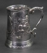 A George III silver mug, London 1790, makers mark R E, of tapering circular form on a skirted foot,