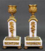 A pair of Louis XVI style gilt metal mounted white marble candlesticks, circa 1880,