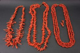 A single strand red coral necklace, set with coral fronds of graduated design,