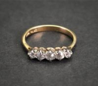 An 18ct gold and five-stone diamond ring,