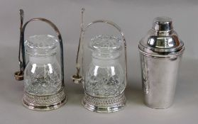 A pair of electroplate pickle jar stands and forks,